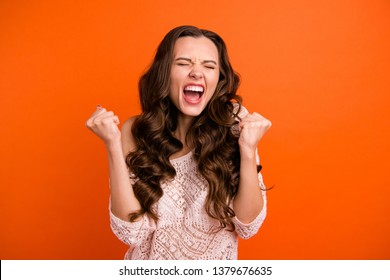 Portrait of her she nice attractive lovely charming crazy cheerful cheery wavy-haired lady showing excitement winning gesture isolated over bright vivid shine orange background