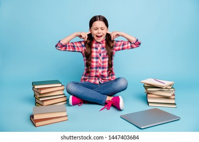 Portrait of her she nice attractive negative desperate girl in checked shirt sitting in lotus pose closing ears avoiding stress isolated on bright vivid shine blue background