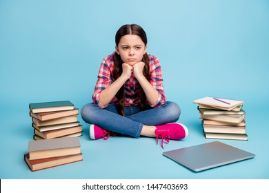 Portrait of her she nice attractive smart clever disappointed girl wearing checked shirt sitting in lotus pose waiting inspiration isolated over bright vivid shine blue green background