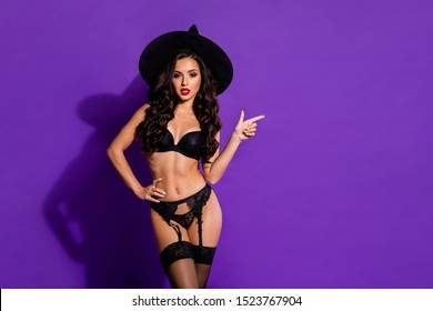 Portrait of her she nice attractive stunning gorgeous confident wavy-haired lady pointing aside recommend October autumn isolated on bright vivid shine vibrant violet purple lilac color background