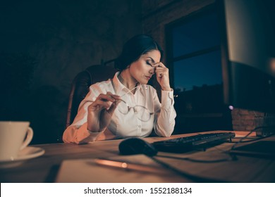 Portrait of her she nice attractive exhausted lady economist auditor attorney lawyer top executive manager completing difficult task deadline at night dark work place station indoors