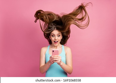Portrait of her she nice attractive lovely charming cheerful cheery straight-haired girl using digital device 5g app ideal silky soft hair flying isolated on pink pastel color background