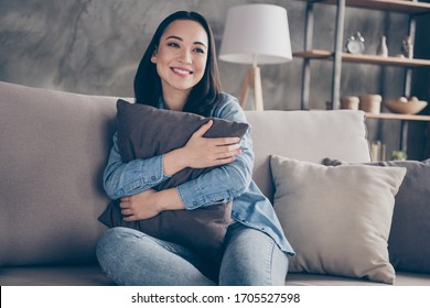 Portrait of her she nice attractive lovely pretty charming cheerful cheery girl sitting on divan alone spending free time in modern loft industrial house apartment flat