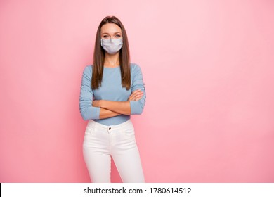 Portrait of her she nice attractive healthy girl wearing safety cotton reusable mask folded arms stop flue influenza pandemia viral pneumonia therapy isolated over pink pastel color background