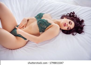 Portrait of her she nice fit slim attractive lovable chic stunning tender sweet romantic girl lying on white linen cuddling self herself enjoying joy single life loneliness