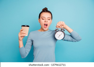 Portrait of her she nice-looking attractive lovely drowsy sleepy girl holding in hands hot sweet coffee take-away retro clock isolated over bright vivid shine turquoise background