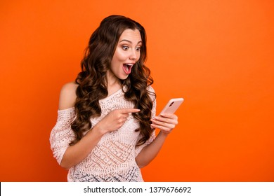Portrait of her she nice-looking attractive lovely feminine cheerful cheery wavy-haired lady in white transparent blouse using 5g showing sms isolated over bright vivid shine orange background
