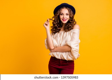 Portrait of her she nice-looking attractive fascinating winsome lovely pretty cheerful cheery girlish wavy-haired lady playing with curls isolated over bright vivid shine yellow background