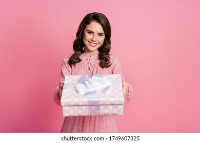 Portrait of her she nice-looking attractive lovely pretty charming cute cheerful cheery wavy-haired girl getting receiving giftbox romantic date isolated over pink pastel color background