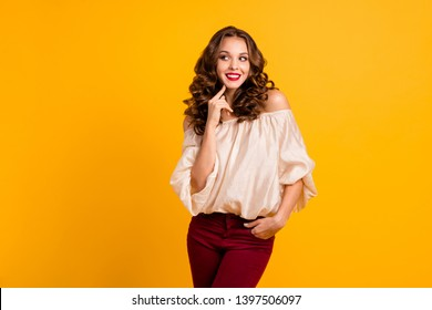 Portrait of her she nice-looking well-groomed attractive stunning fascinating winsome shy cheerful cheery wavy-haired girl touching chin isolated over bright vivid shine yellow background