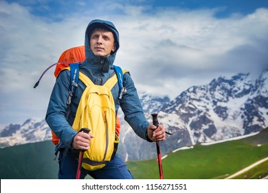 Portrait of hiker in mountains in sportswear. Tourist is on hiking trek. Adventure hike along hills and mountains. Climber in highland.