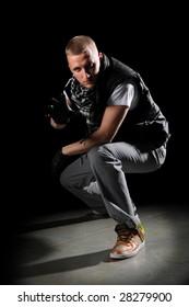 Portrait of hip hop dancer performing on the spotlight