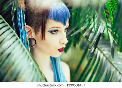 Portrait of a hip young woman with blue hair