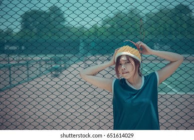 Portrait of hipster girl pose for take a photo on the fence vintage style,pastel tone