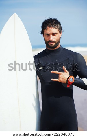 Portrait of hipster guy with white surfboard standing on ocean the beach 0c581975e