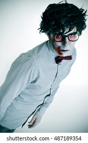 portrait of a hipster zombie wearing shirt, bow tie and black plastic-rimmed eyeglasses