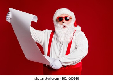 Portrait of his he attractive amazed fat white-haired Santa holding in hands reading wish present gift list pout lips order isolated bright vivid shine vibrant red burgundy maroon color background - Shutterstock ID 1824663248