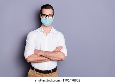 Portrait of his he attractive healthy guy wearing safety gauze mask folded arms stop influenza mers cov pandemia copy space preventive measures isolated gray color background