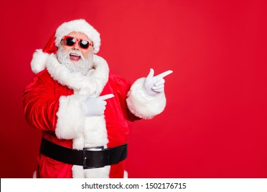 Portrait of his he cheerful cheery funky fat overweight plump gray-haired bearded man pointing choose choice decision gift present surprise isolated over bright vivid shine red background