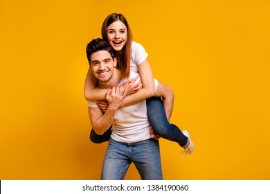 Portrait of his he her she two nice attractive adorable cheerful optimistic tender people wife husband having fun spare time isolated over vivid shine bright yellow background