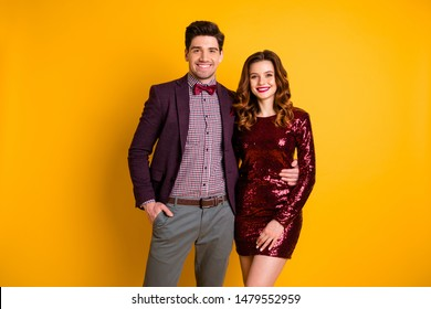 Portrait of his he her she nice-looking attractive elegant charming smart cheerful cheery people spending holiday isolated over bright vivid shine yellow background