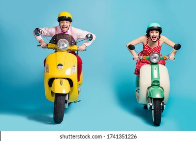 Portrait of his he her she nice attractive cheerful glad ecstatic crazy overjoyed couple riding moped having fun fast speed isolated on bright vivid shine vibrant blue color background