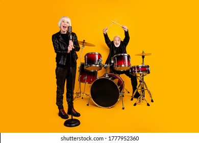Portrait of his he her she nice attractive cheerful excited grey-haired couple performing singing playing live show scene fame isolated over bright vivid shine vibrant yellow color background