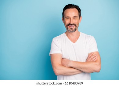 Portrait of his he nice attractive cheerful cheery glad content mature guy self-employed freelancer folded arms isolated over bright vivid shine vibrant teal green blue turquoise color background