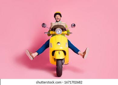 Portrait of his he nice attractive funky ecstatic overjoyed cheerful cheery guy riding moped fooling having fun carrying dessert sweet pie isolated over pink pastel color background