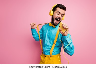 Portrait of his he nice attractive cheerful cheery dreamy bearded guy meloman wearing mint shirt singing single hit enjoying leisure weekend isolated on pastel pink color background