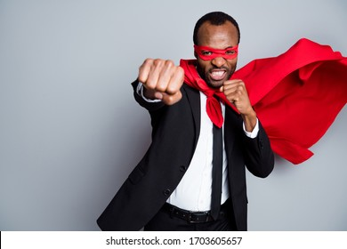 Portrait of his he nice attractive aggressive mad evil guy wearing suit hero look mask fighting enemy struggling fair play ring air wind blow fly isolated over grey pastel color background