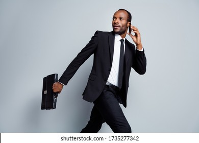 Portrait of his he nice attractive classy rich wealthy imposing guy seeker hr recruiter agent broker banker going talking on phone cv resume interview isolated over grey pastel color background