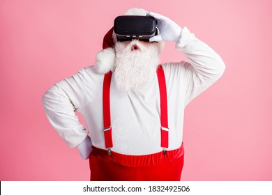 Portrait of his he nice attractive impressed bearded fat overweight Santa watching vr wear helmet enjoying pastime weekend wow omg illusion isolated pink pastel color background