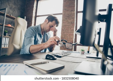 Portrait of his he nice attractive tired guy leader partner coding programming feeling bad overwork difficult task debug test qa at modern industrial interior loft brick style work place station