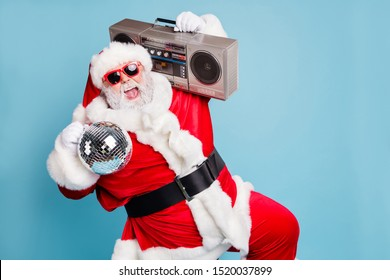 Portrait of his he nice cool fat cheerful cheery glad excited ecstatic overjoyed crazy carefree bearded Santa carrying tape player dancing having fun isolated on blue turquoise pastel color background