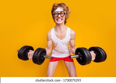 Portrait of his he nice funky motivated mad foxy guy lifting barbell doing work out trainer program regime body building goal isolated over bright vivid shine vibrant yellow color background