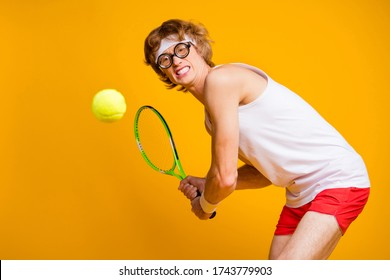 Portrait of his he nice funky motivated successful guy playing court tennis serving hit intense physical practicing isolated over bright vivid shine vibrant yellow color background