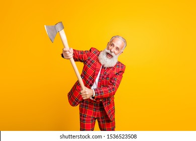 Portrait of his he nice handsome attractive crazy mad funky gray-haired man cutting invisible object with ax isolated over bright vivid shine vibrant yellow color background