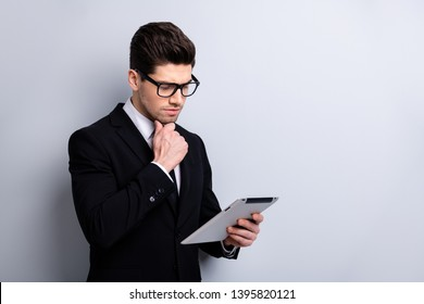 Portrait of his he nice imposing elegant classy attractive pensive guy new digital ebook surfing web site blog law economist auditor sales agent broker isolated over light gray background