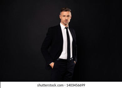 Portrait of his he nice-looking attractive chic gorgeous content guy financier executive director economist auditor attorney lawyer ceo boss chief isolated over dark black background