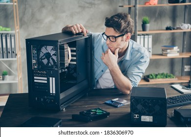 Portrait of his he serious nice attractive focused guy geek skilled expert technician guarantee service testing repairing hardware at modern loft industrial home office workplace workstation