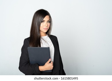 Portrait of a hispanic businesswoman working at her job in the office