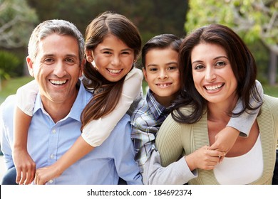 Portrait Of Hispanic Family In Countryside
