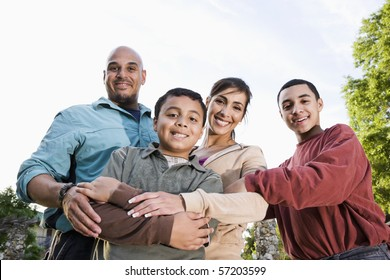 Portrait of Hispanic family with two boys outdoors