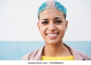 Portrait of hispanic gay woman looking at camera - Focus on face