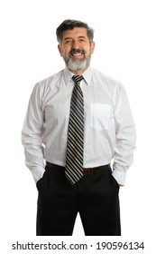 Portrait of Hispanic senior businessman with hands in pockets isolated over white background