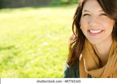Portrait of a hispanic woman outdoors.