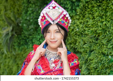 portrait of Hmong young woman in tradition Hmong costume for young girl; Asian ethnic tribal people in traditional colorful clothing culture of Hmong or Miao people in east Asia and southeast Asia