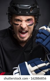 Portrait of hockey player with screaming angry look. Without One tooth