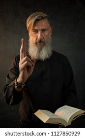 Portrait of a holy priest in front of a dark background